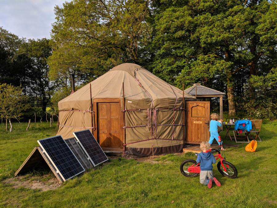 yurt, solar panels and boys