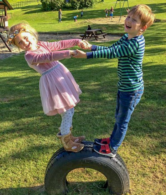 two children on a tyre