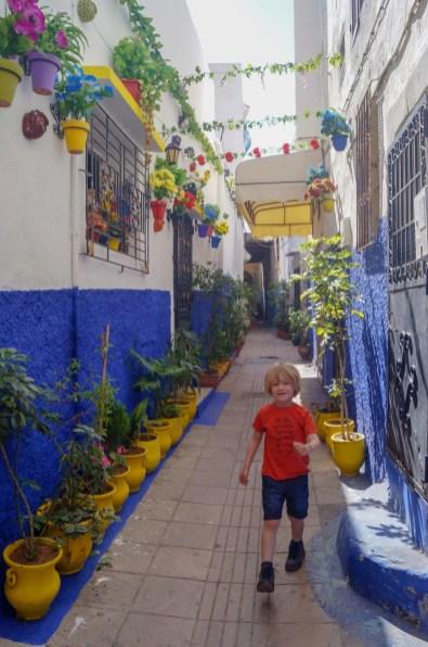 boy walking down street in Rabat