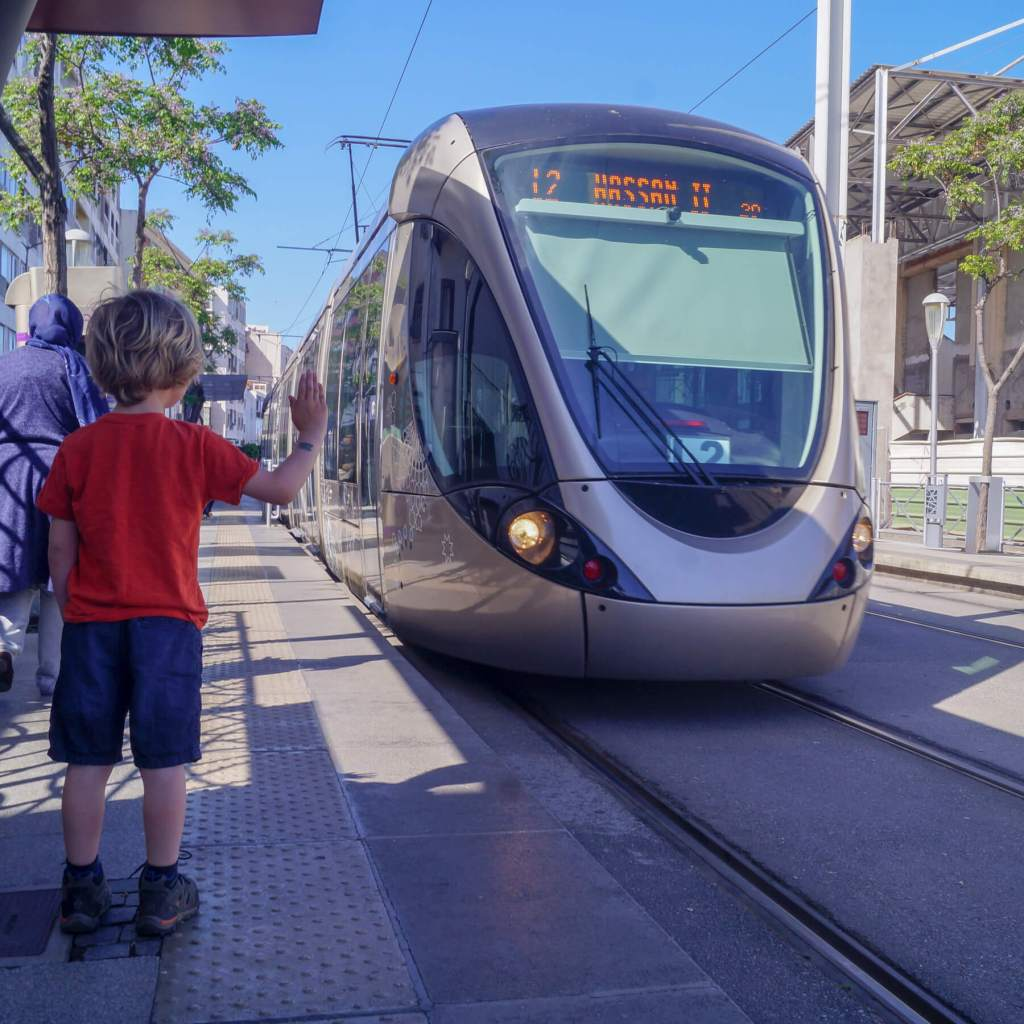 a boy stopping a tram