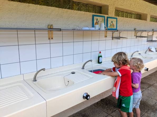 two boys washing up
