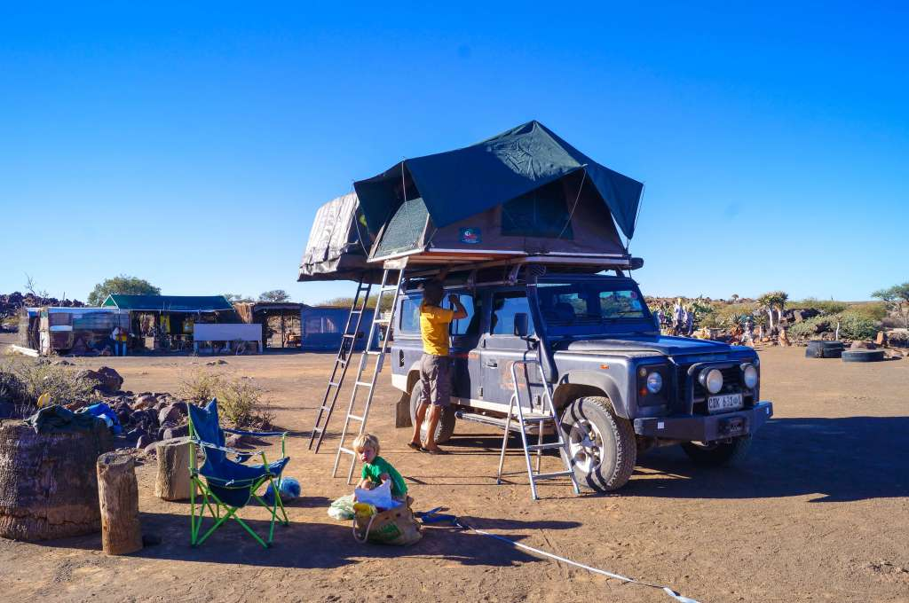 setting up camp. landrover with roof tents