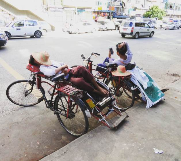 snoozing on trishaws in Yangon