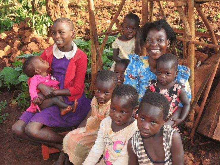 Ugandan women and girls smiling at Camera