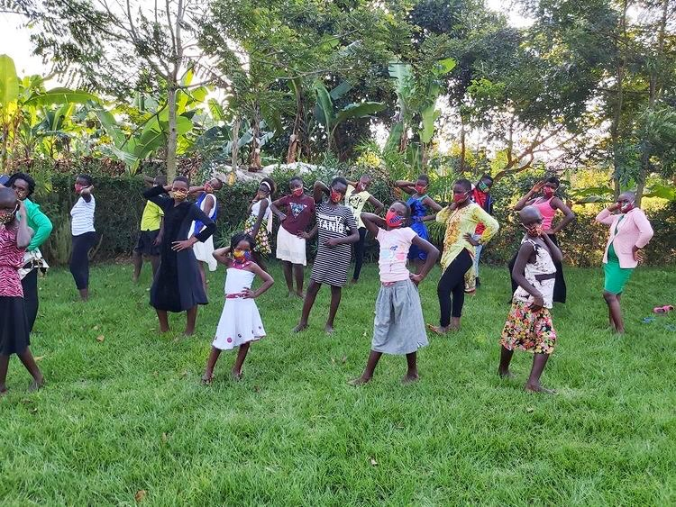 Bringing hope to girls and women in Uganda. Posing for the camera