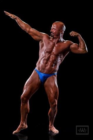 "Bodybuilder Doing ""The Arnold"" Pose"