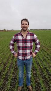 Ashton Trawin standing in a winter triticale crop