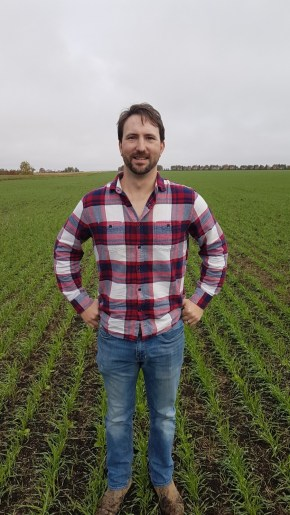 Ashton Trawin standing in a winter triticale crop