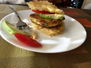 Rice hamburgers with zucchini patties, avocado and tomatoes