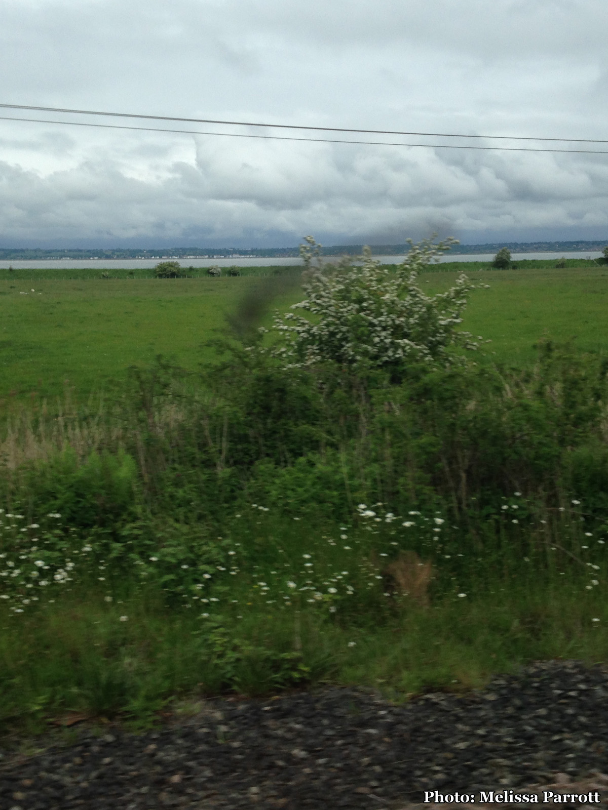Here in North Wales, the train passengers primarily spoke Welsh, both young and old, families and young adults. It was nice to hear the old language. The tracks now ranparallel to the Irish Sea and the River Dee, with water on one sideandmountains starting to loom on the other.