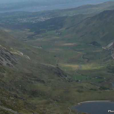 We hiked for hours and it was hot and arduous.  He kept the pace and I could barely keep up.  There wasn't much wildlife, but when I did look up, past the next foothold, and spun my head around to see the view, the whole Ogwen Valley was spread out before me.