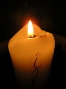 candle flame is like writing in the face of tragedy