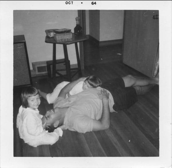 Playing in the floor in our first home.