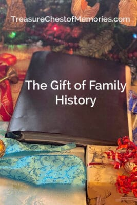 The gift of Family history pinnable graphic with black binder and festively wrapped gifts