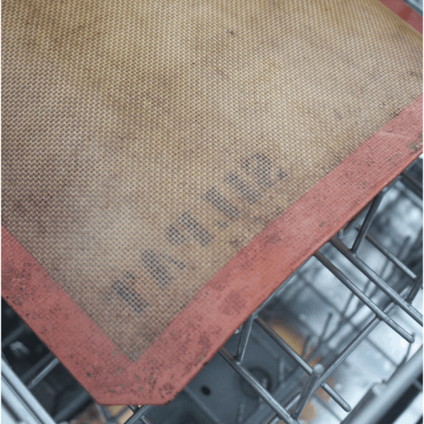 Silpat baking silicon in dishwasher basket for Surprising Things you can Clean in your Dishwasher post