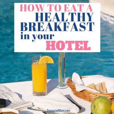 healthy hotel breakfast with orange juice, fruit, toast near pool