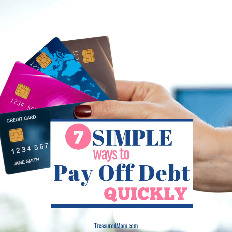 picture of hand with credit cards for 7 simple ways to pay off debt quickly