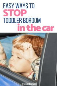 toddler in carseat reading with mom for road trip activities for toddlers article