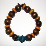 Bracelet     Size  Medium/Adult Female   3.75 in Made  with Leather Cord and 20 Wood Beads Price: $5.00