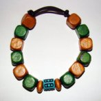 Bracelet     Size Large/Adult Male   4.25  in to 5 in Made with Leather Cord, 14 Wood Beads and 1 Plastic Bead Price: $5.00
