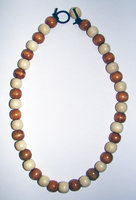 Necklace     Size  Medium Adult   9.5 in Made with Leather Cord and 40 Wood Beads  Price: $10.00