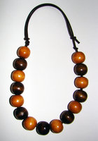 Necklace     Size  Small/Adult  8.5 in to 11.5 in Made with Leather Cord and 15 Wood Beads  Price: $7.00
