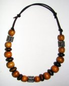 Necklace     Size  Small/Child   6.5 in to 8.5 in Made with Leather Cord, 20 Wood Beads and 3 Plastic Beads  Price: $7.00