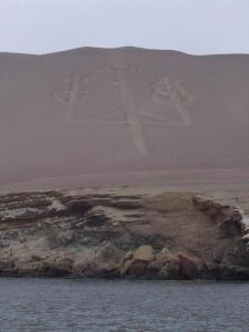 A large geoglyph that has been etched into the desert hillside in the shape of a candelabra, a large branched candlestick.