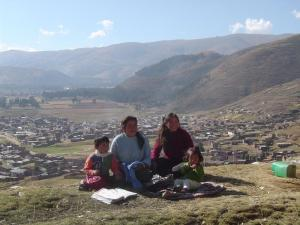 Two Peruvian mothers enjoying the afternoon and the view of Huancayo with their children from Torre Torre Park.