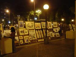 A local artist selling their work in a plaza in Lima, Peru.