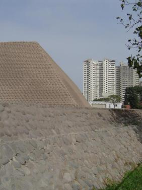 The Huaca Huallamarca Adobe Pyramid is surrounded by modern constructions in Lima's financial district San Isidro.