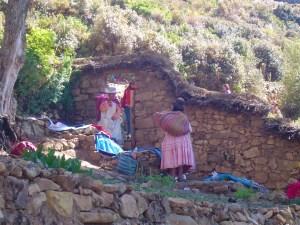 Bolivian women washing their clothes on Isla del Sol.