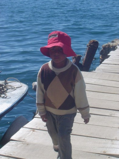 Bolivian boy on one of the docks of Isla del Sol.