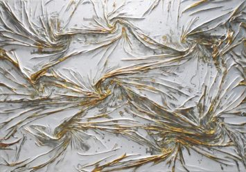 Textured white and gold - mixed media using Cloth, enamel, and liquid gold leaf on wood
