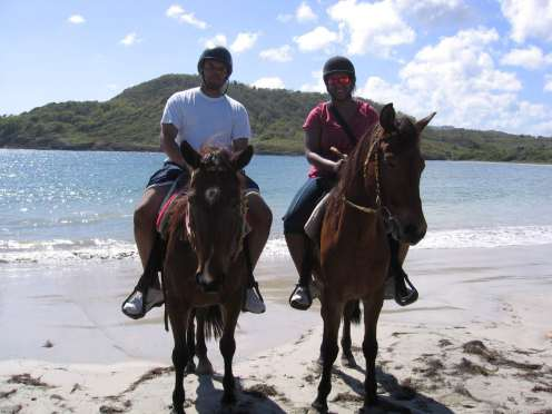 Dr. and Mr. Newman - riding horses on the beach