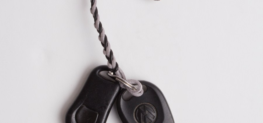 Mixed grey braided pacifier clip attached to keys