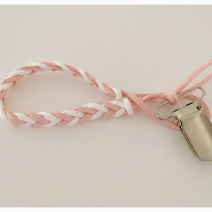 Pink and white braided pacifier clip