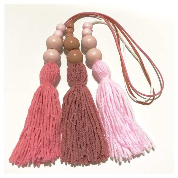 shades of pink tassel wall hangings