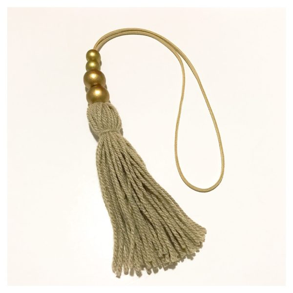 Bronze tassel wall hangings