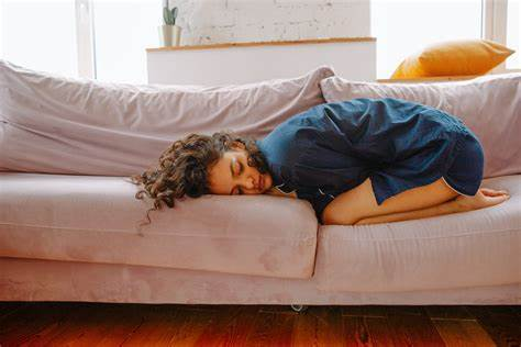 Woman Crouching on Couch