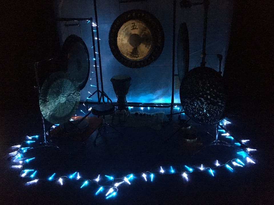 Gong bath setup in the dark at Yard Theatre in Hulme, Manchester