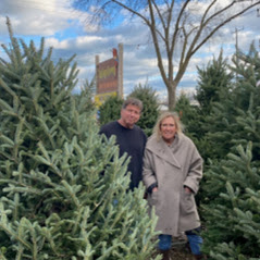 Tree Man a Lady (Paul and Claire) in Christmas Tree lot