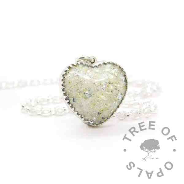 New style heart necklace setting with scalloped edge. Unicorn white resin sparkle mix, umbilical cord and silver leaf, shown with a medium classic chain upgrade (mockup of new setting) umbilical cord heart necklace