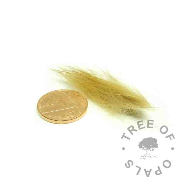 ideal fur amount with penny for scale. This is enough fur to make around two orbs, charms or rings