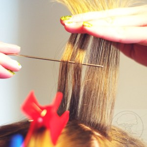 section off a slice of hair and weave in and out then cut a few of the strands, so as not to get a bald patch. Cut near the root for short hair, or a 10cm length for long hair