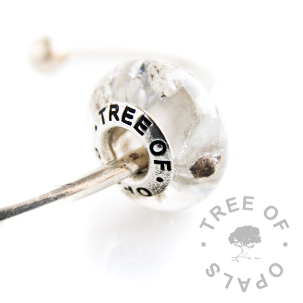 crystal clear resin cremation ash charm with subtle silver leaf