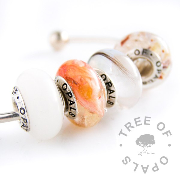 charm sets, four charms for European bracelets like Pandora or Trollbeads, which can be made with your own loved ones' elements