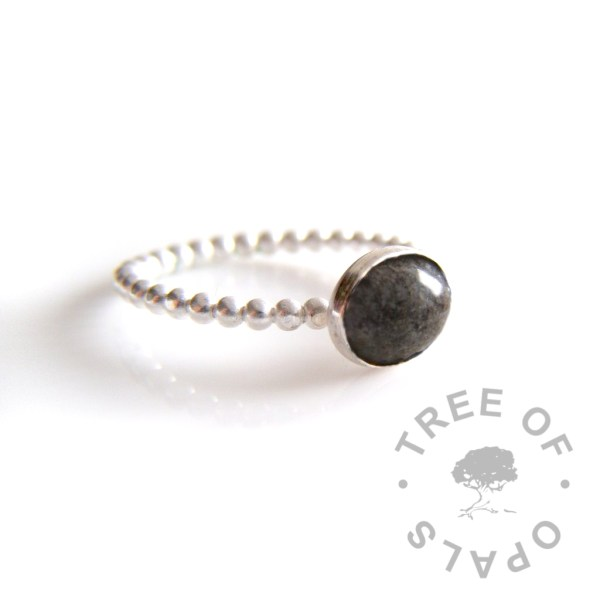 cremation ash ring on bubble wire band with naturally dark ash and clear resin