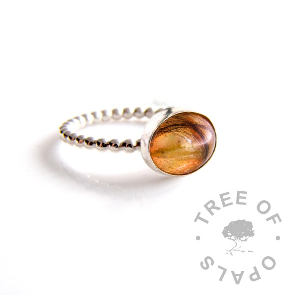 flower ring with crysanthemum petals, lock of hair and umbilical cord on bubble wire band