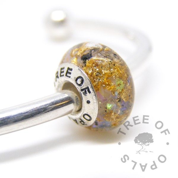 cremation ashes bead in resin, white opalescent and genuine gold leaf with a solid sterling silver Tree of Opals branded core cremation ash charm, for Pandora bracelets, white background cutout watermarked image, copyright 2017